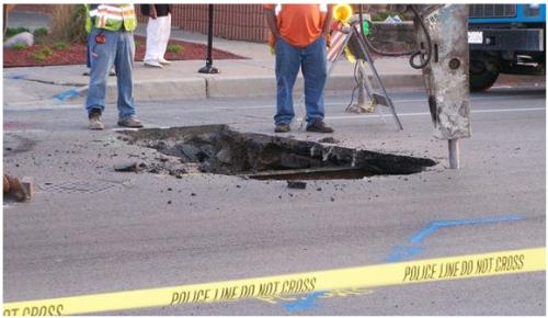 Photo Credit: Sarah Collins Lawrence Ave pothole disrupts traffic September 10, 2009